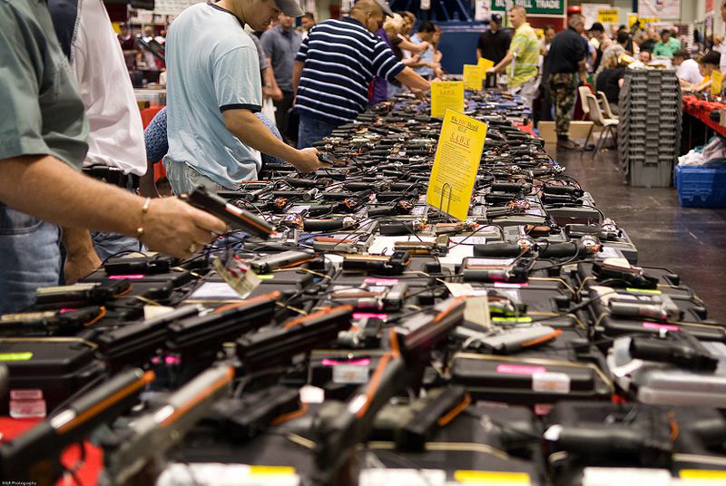 Visitors at a gun show in Houston, Texas (photo by http://flickr.com/photos/glasgows/ (http://flickr.com/photos/glasgows/432945997/) [CC BY 2.0 (http://creativecommons.org/licenses/by/2.0)], via Wikimedia Commons (https://commons.wikimedia.org/wiki/File:Houston_Gun_Show_at_the_George_R._Brown_Convention_Center.jpg)